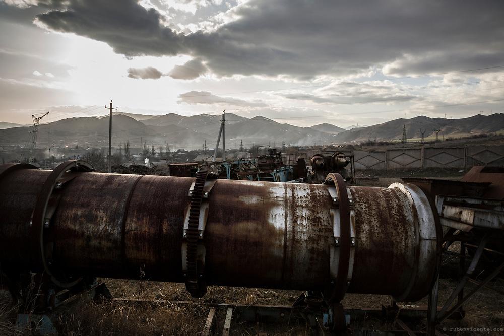 Abandoned industry equipment in a field. Shirak, Armenia