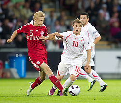 AALBORG, DENMARK - Saturday, June 11, 2011: Denmark's Nicolai Boilesen (AFC Ajax) and Switzerland's Xherdan Shaqiri (FC Basel 1893) during the UEFA Under-21 Championship Denmark 2011 Group A match at the Aalborg Stadion. (Photo by Vegard Grott/Propaganda)