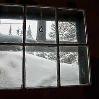 inside of snow covered ranger cabin in glacier national park, two medicine valley, montana