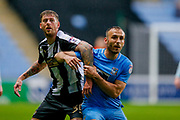 Notts County forward Jonathan Stead (30) battles with Coventry City defender Liam Kelly (6)  during the EFL Sky Bet League 2 match between Coventry City and Notts County at the Ricoh Arena, Coventry, England on 12 May 2018. Picture by Simon Davies.