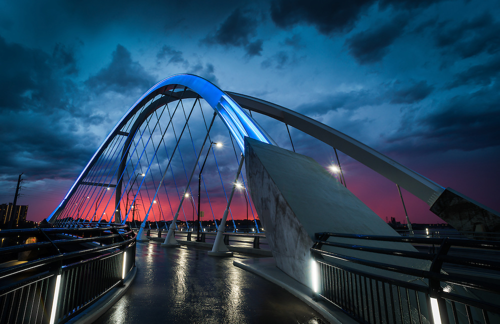 The Lowry Avenue Bridge as a summer storm passes during sunset.  The bridge spans the Mississippi River in Northeast Minneapolis.  <br />