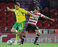 Doncaster - Tuesday September 14th, 2010:  Norwich City's Chris Martin and Doncaster Rovers's John Oster in action during the NPower Championship match at Keepmoat Stadium, Doncaster. (Pic by Dave Howarth/Focus Images)