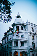 The facade of an old building, now the Queen Hotel, on the corner of Bogambara Lake in downtown Kandy, Sri Lanka, Asia