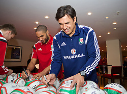 CARDIFF, WALES - Tuesday, March 4, 2014: Wales' manager Chris Coleman and captain Ashley Williams sign footballs during a signing session at the St. David's Hotel ahead of the International Friendly against Iceland. (Pic by David Rawcliffe/Propaganda)  CARDIFF, WALES - Tuesday, March 4, 2014: Wales' xxxx during a training session at the Cardiff City Stadium ahead of the International Friendly against Iceland. (Pic by David Rawcliffe/Propaganda)