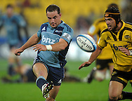Blues halfback Alby Mathewson kicks. Super 15 rugby match - Hurricanes v Blues at Westpac Stadium, Wellington, New Zealand on Friday, 30 April 2011. Photo: Dave Lintott / photosport.co.nz