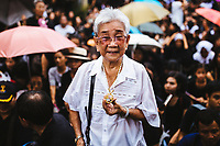 A n older Thai woman holds on a pendant with King Bhumibol on June 14, 2016 in Bangkok, Thailand. Thailand's King Bhumibol Adulyadej, the world's longest-reigning monarch, died at the age of 88 in Bangkok's Siriraj Hospital on Thursday after his 70-year reign. Prime Minister Prayut Chan-ocha made a statement Thailand would hold a one-year mourning period as the Crown Prince Maha Vajiralongkorn confirmed that he would perform his duty as heir to the throne.