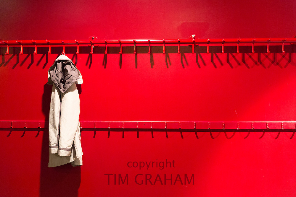 One jacket hanging on hook in minimalist modern cloakroom at Arken Museum of Modern Art, nr Copenhagen, Denmark