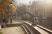 PARIS, FRANCE - December 1, 2013: Sitting along the bank of the Canal Saint Martin in the 10th Arrondissement. <br /> <br /> CREDIT: Clay Williams.<br /> <br /> © Clay Williams / http://claywilliamsphoto.com
