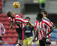 Photo: Lee Earle.<br /> Southampton v Derby County. Coca Cola Championship. 04/02/2006. Saint's Dexter Blackstock (L) controls the ball as team mate Kenwyne Jones (R) watches.