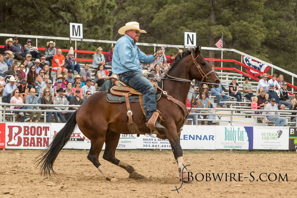 Heeler TW Wilson makes his team roping run during the third performance of the Elizabeth Stampede on Sunday, June 3, 2018.