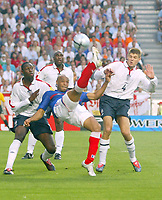 England v France - Estadio de Luz, Lisbon - 13th June 2004<br />France's Thierry henry flicks an overhead kick past Ledley King (l) Sol Campbell (centre) and Steven Gerrard (r)<br />Photo: Jed Leicester/Sporting Pictures<br />© Sporting Pictures (UK) Ltd<br />www.sportingpictures.com<br />Tel: +44 (0)20 7405 4500<br />Fax: +44 (0)20 7831 7991
