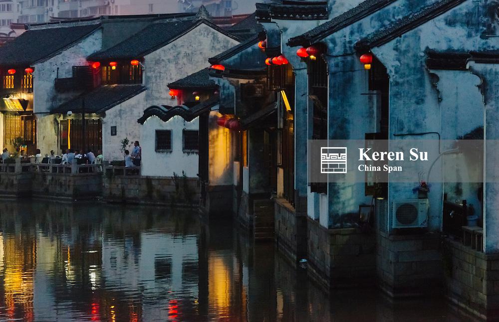 Night view of traditional houses along the Grand Canal, ancient town of Yuehe in Jiaxing, Zhejiang Province, China