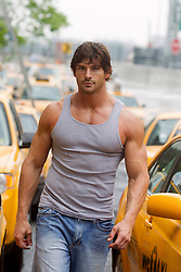 very rugged man with a great body walking in New York City