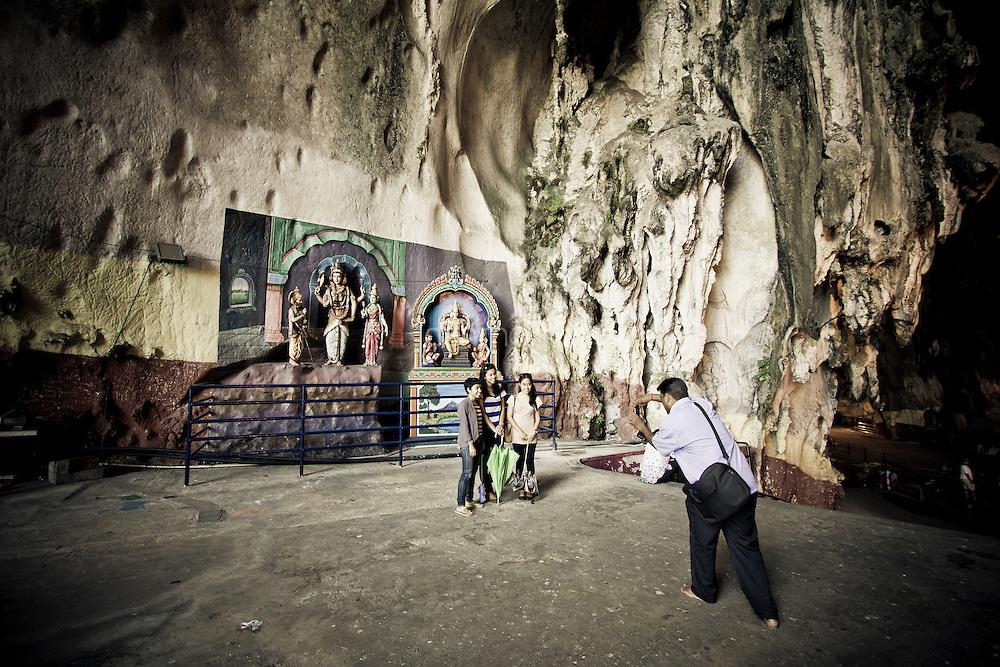 Family photography in front of Hindu mural, Batu Caves, Kuala Lumpur