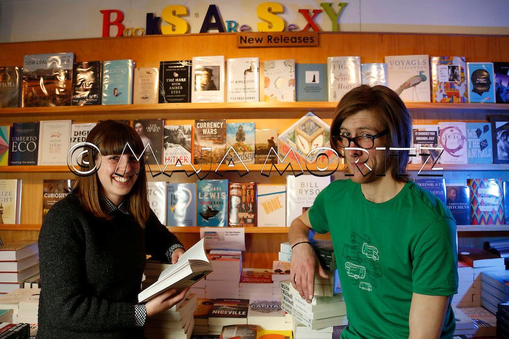 Books are sexy is the motto in the Time Out Bookstore in Mount Eden Village, Auckland, New Zealand, employees Louisa Kasza and Henry Swanson indulge in books every day