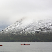 Kayakers with Kayak Adventures, Queenstown, are greeted with  November snow covering surrounding mountain ranges during an early morning paddle on Lake Wakatipu, Queenstown, New Zealand. 4th November, 2011