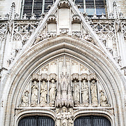 Decorated arch over the main doorway at the Cathedral of St. Michael and St. Gudula (in French, Co-Cathédrale collégiale des Ss-Michel et Gudule). A church was founded on this site in the 11th century but the current building dates to the 13th to 15th centuries. The Roman Catholic cathedral is the venue for many state functions such as coronations, royal weddings, and state funerals. It has two patron saints, St Michael and St Gudula, both of whom are also the patron saints of Brussels.