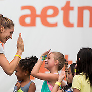 August 16, 2014, New Haven, CT:<br /> Andrea Petkovic high fives kids during a tennis clinic in the AETNA FitZone as part of Kids Day on day three of the 2014 Connecticut Open at the Yale University Tennis Center in New Haven, Connecticut Sunday, August 17, 2014.<br /> (Photo by Billie Weiss/Connecticut Open)