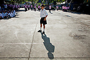 Sept. 23, 2009 -- BANGKOK, THAILAND: A boy waits for class to start in front of a government public school in the Khlong Toey slum in Bangkok. Khlong Toey slum in Bangkok, Thailand, is the largest slum area in Bangkok. Photo by Jack Kurtz
