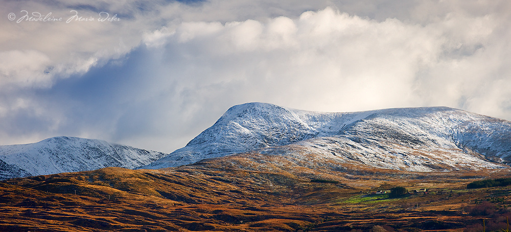 Snow on Peak Panorama in Kerry HIghlands with cottages and fresh winterlight sunset Ireland / ba051