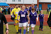 City of Liverpool's captain Christopher Lester leads his team out during the North West Counties League Play Off Final match between Litherland REMYCA and City of Liverpool FC at Litherland Sports Park, Litherland, United Kingdom on 13 May 2017. Photo by Craig Galloway.