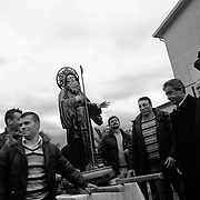 Italy, Basilicata- The arrival of S.Francesco, under control of he parson © 2012 Mama2
