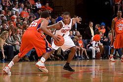 Virginia guard Sean Singletary (44) guards Clemson guard Cliff Hammonds (25).  The Virginia Cavaliers men's basketball team fell the Clemson Tigers at 82-51 the John Paul Jones Arena in Charlottesville, VA on February 7, 2008.