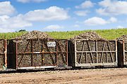 harvested sugar cane train ready for crushing under cumulus cloud in Kuttabul, Queensland, Australia <br />