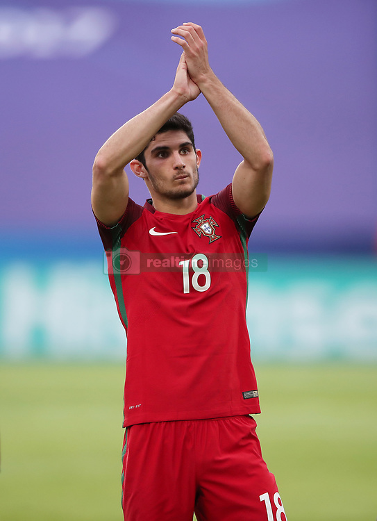 Portugal's Goncalo Guedes applauds fans after the final whistle