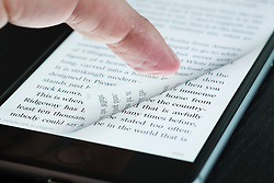 Turning page of ebook with finger on an iPhone 6 plus smart phone
