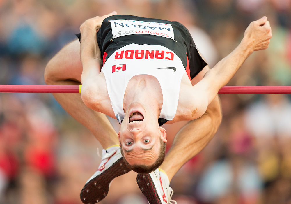 Mike Mason of Canada competes in the men's high jump at the 2015 Pan American Games at CIBC Athletics Stadium in Toronto, Canada, July 25,  2015.  AFP PHOTO/GEOFF ROBINS