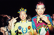 Two crazy ravers in bright fluorescent clothing, Homelands, UK 2000