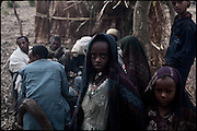 """Parents, relatives and friends of three young girls, who are being married, attend the celebration of the early marriage. North West of Ethiopia, on monday, Febrary 16 2009.....In a tangled mingling of tradition and culture, in the normal place of living, in a laid-back attitude. The background of Ethiopia's """"child brides"""", a country which has the distinction of having highest percentage in the practice of early marriages despite having a law that establishes 18 years as minimum age to get married. Celebrations that last days, their minds clouded by girls cups of tella and the unknown for the future. White bridal veil frame their faces expressive of small defenseless creatures, who at the age ranging from three to twelve years shall be given to young brides men adults already...To protect the identities of the recorded subjects names and specific places are fictional."""