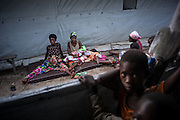 DRC / Burundi Refugees / Women seat on mattresses outside of their tent in Kavimvira transit centre run by<br /> UNHCR in Uvira, DRC's South Kivu Province.<br /> 500 vulnerable Burundian refugees are hosted in Kavimvira transit centre. The<br /> majority are women and children.<br /> <br /> 7,661 Burundians refugees have crossed into the DRC over the past few weeks. The new<br /> arrivals are being hosted by local families, but the growing numbers are straining<br /> available support. UNHCR is helping some 500 vulnerable refugees at a transit centre<br /> at Kavimvira and in another centre at Sange. Work is ongoing to identify a site<br /> where all the refugees can be moved, and from where they can have access to<br /> facilities such as schools, health centers and with proper security. / UNHCR / F.Scoppa / May 2015