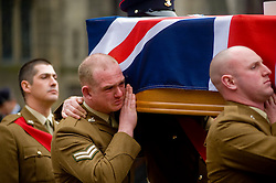 """Led by Revd Helen Guest the barer party made up of Soldiers from The Yorkshire Regiment carry Corporal Liam Rileys coffin out of Sheffield Cathedral where his Funeral service took place on Wednesday 24 February. ..Corporal Riley of 3rd Battalion Yorkshire Regiment who died in an explosion in Afghanistan on 1 February 2010 while on foot patrol south of the Kings Hill check point Helmand. ..Upon hearing of Liam's death he was described by Price Harry as """"a legend"""""""