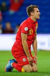 Aaron Ramsey of Wales (Arsenal) looks disappointed after being beaten to the ball by Goalkeeper Vladimir Stojkovic of Serbia (Partizan Belgrade) during the first half of the match - Photo mandatory by-line: Rogan Thomson/JMP - Tel: Mobile: 07966 386802 10/09/2013 - SPORT - FOOTBALL - Cardiff City Stadium - Cardiff -  Wales V Serbia- World Cup Qualifier.