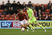 Brighton winger, Jamie Murphy (15) and Nottingham Forest midfielder David Vaughan (24) during the Sky Bet Championship match between Nottingham Forest and Brighton and Hove Albion at the City Ground, Nottingham, England on 11 April 2016.