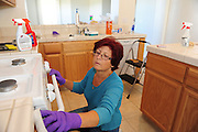 SUN-STAR PHOTO BY BEA AHBECK<br /> Renate cleans a house while working her cleaning business in Merced, Calif. Nov. 20, 2010.