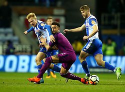 Kyle Walker of Manchester City is tackled by David Perkins of Wigan Athletic - Mandatory by-line: Robbie Stephenson/JMP - 19/02/2018 - FOOTBALL - DW Stadium - Wigan, England - Wigan Athletic v Manchester City - Emirates FA Cup fifth round proper