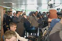 09 AUG 2001, BERLIN/GERMANY:<br /> Gerhard Schroeder, SPD, Bundeskanzler, schaut fuer die versammelten Kameraleute und Fotografen durch ein Fernglas mitten in die Objektive hinein, waehrend einem Besuch von Marineeinheiten im Seegebiet vor Rostock, auf der Kommandobrücke des Tenders DONAU<br /> IMAGE: 20010809-01-017<br /> KEYWORDS: Bundeswehr, Bundesmarine, Marine, Gerhard Schröder, Kamera, Fotograf, Photographer