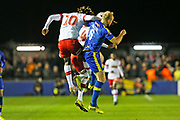 Freddie Ladapo and Alex Gudger compete for the ball during the The FA Cup match between Solihull Moors and Rotherham United at the Automated Technology Group Stadium, Solihull, United Kingdom on 2 December 2019.