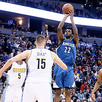 15 February 2017: Minnesota Timberwolves forward Andrew Wiggins (22) takes a jump shot over Denver Nuggets guard Will Barton (5) and Denver Nuggets forward Nikola Jokic (15) next to Minnesota Timberwolves center Karl-Anthony Towns (32) during the Minnesota Timberwolves 112-99 victory over the Denver Nuggets, at the Pepsi Center, Denver, Colorado, USA.