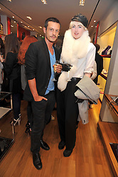 JONATHAN SAUNDERS and PHOEBE ARNOLD at a party in aid of the charity Best Buddies held at the Hogan store, 10 Sloane Street, London SW10 on 13th May 2009.