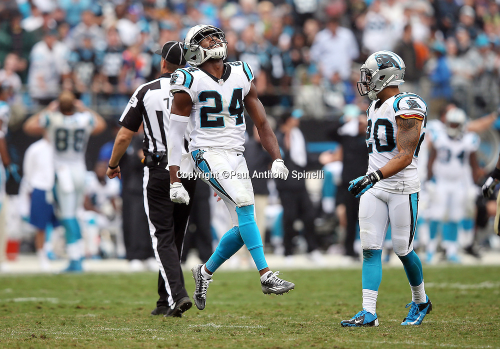 Carolina Panthers cornerback Josh Norman (24) jumps in the air as he celebrates during the 2015 NFL week 3 regular season football game against the New Orleans Saints on Sunday, Sept. 27, 2015 in Charlotte, N.C. The Panthers won the game 27-22. (©Paul Anthony Spinelli)