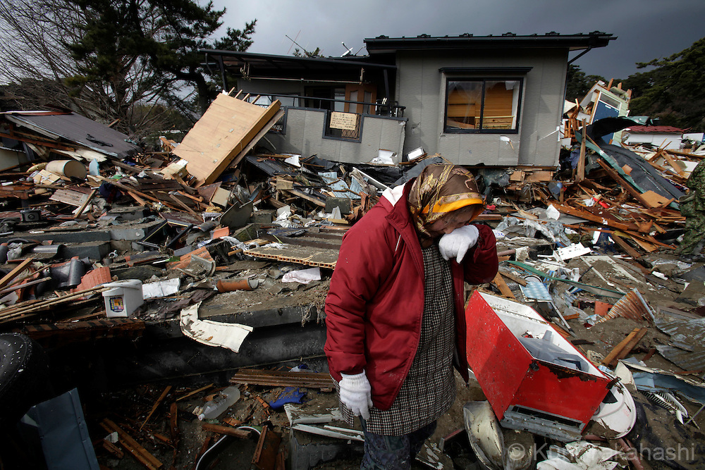A woman weeps as she returned to check her house in Kadonowaki-cyo in Ishinomaki, Miyagi, Japan after massive earthquake and tsunami hit northern Japan. More than 20,000 were killed by the disaster on March 11.<br /> Photo by Kuni Takahashi