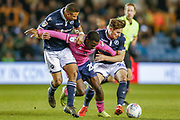Queens Park Rangers midfielder Bright Osayi-Samuel (20) struggles to keep possession as he is challenged by Millwall defender Ryan Leonard (28) and Millwall defender James Meredith (3)  during the EFL Sky Bet Championship match between Millwall and Queens Park Rangers at The Den, London, England on 10 April 2019.