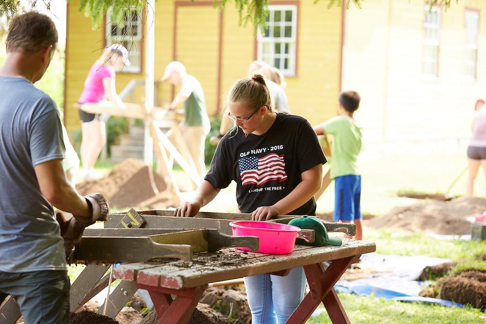 Activity; Volunteering; Location; Outside; People; Alumni; Student Students; Children; Professor; Summer; July; Time/Weather; sunny; Type of Photography; Candid; UWL UW-L UW-La Crosse University of Wisconsin-La Crosse; MVAC Field School Open House Mississippi Valley Archeology