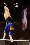 Katie Merritt performs on the bars during the WAC Gymnastics Championship at the San Jose Event Center March 19.  SJSU finished third of six with Merritt scoring a 9.775 on the bars.