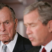 """Pres. Bush, First Lady Laura Bush, former Presidents George H.W. Bush and William Jefferson Clinton, visit embassies of countries devastated by the tsunami Monday, January 3, 2005.  President Bush told reporters at the White House, """"I have asked two of America's most distinguished private citizens to head a nationwide charitable fund-raising effort.""""..Photo by Khue Bui"""