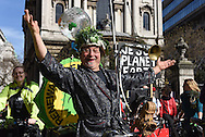 A demonstrator on his bike during the Time To Act, National Climate March organised by Campaign Against Climate Change in London, England on March 7, 2015